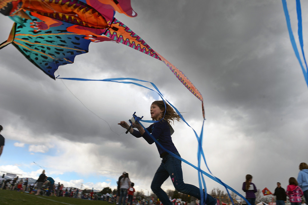 . Vasalisa Malenkiy, 8, of Lafayette,  tries to get her dragon kite in the air during the 12th annual Arvada Kite Festival held at the Stenger soccer complex in Arvada, Colorado, on April 6, 2014.   Hundreds of people braved cold temperatures , some rain and gusty winds to fly their kites  of all different sizes, shapes, and colors.  Activities included kite making classes and competitions for highest kite, smallest kite, largest kite and most visually appealing kite.  (Photo By Helen H. Richardson/ The Denver Post)