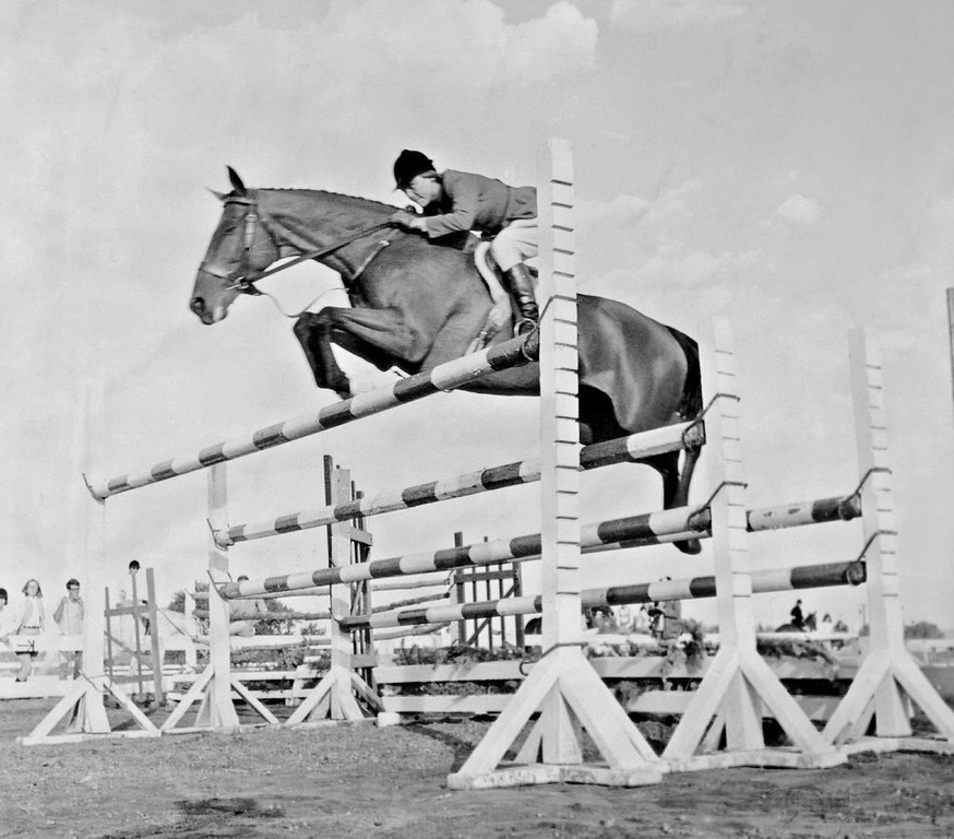 . SEP 3 1966.  Nimble rider Mrs. Wilson Dennehy clears a triple-bar fence at 5 ft. 6 in. for a second place in a puissance strength test at U.S. Equestrian Team Benefit Horse Show.   (Jack Riddle/Denver Post)