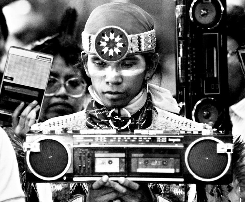 . MAR 20 1988. Clayton George, age 23, from Goldendale, Washington recorded the traditional drum music that accompanied the dancing Saturday at the Pow Wow. George is from the Yakima tribe. (From the Denver Post Archive)