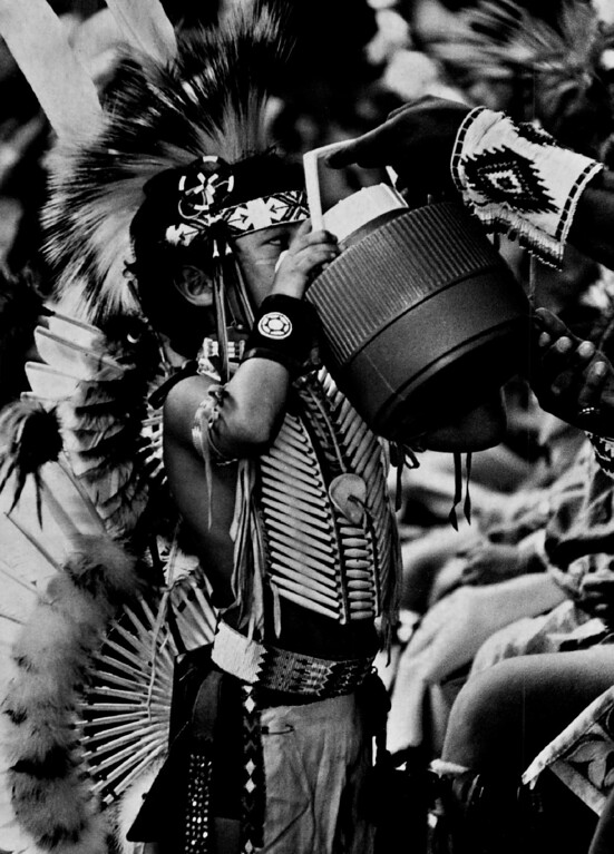 . JUL 20 1974.   The 10th Annual Indian Pow WoW Held at Jeffco Fairgrounds. Weston Weller, a Caddo of Anadarko, Okla.,  won second prize in Saturday\'s competition. He takes a swig of water from a bottle after competing. Members of about 100 Indian tribes took part in event sponsored by White Buffalo Council of American Indians. Traditional dances showed colorful costumes and beating drums.   (David Cupp/Denver Post)