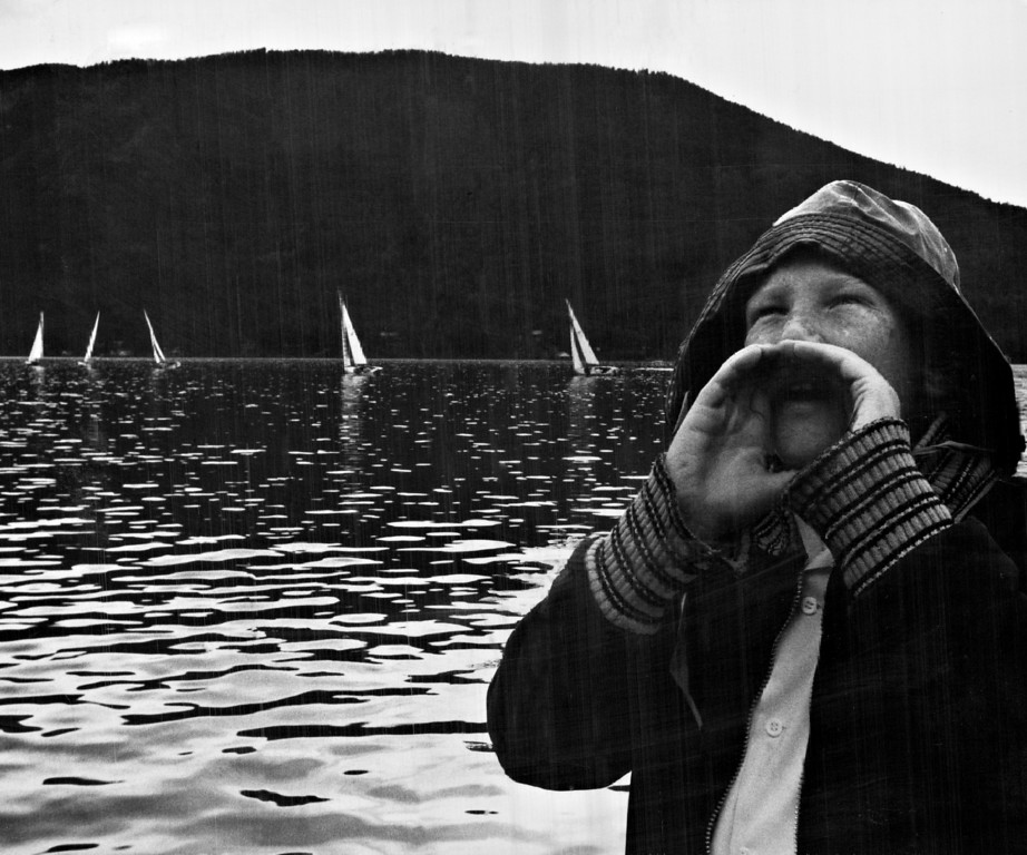 . AUG 16 1959.  Dick McCusker, son of Mr. and Mrs. R. J. McCusker Jr. of Denver, wears the look of an old salt as he hails a friend on shore during the Lipton Cup Race, feature of Colorado\'s annual Grand Lake Regatta which ended Saturday.  (David Mathias/Denver Post)