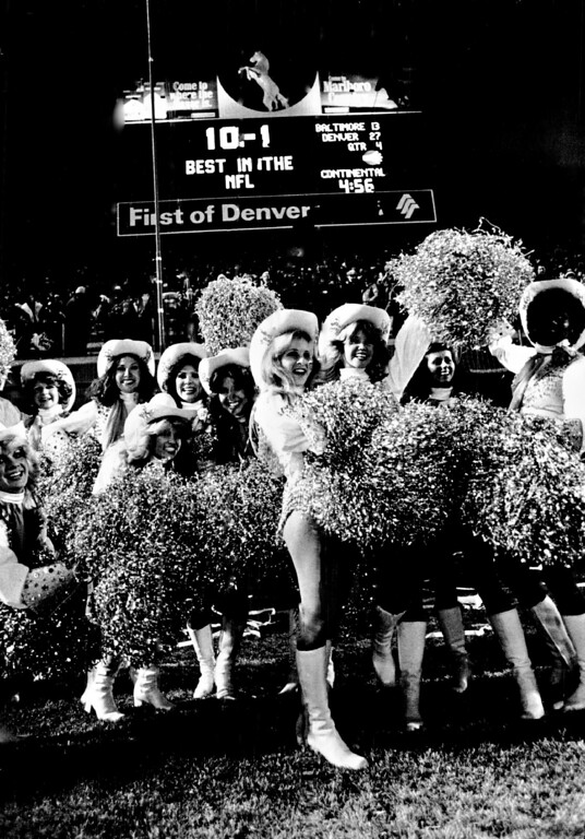 . NOV 27 1977.  The Pony Express Cheerleaders celebrate the certain victory over Colts.  (Lyn Alweis/The Denver Post)