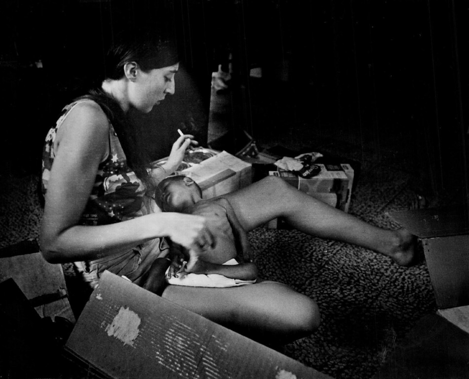 . APR 4 1975.  Christy Leibermann holds a sick child at Allambie nursery in Saigon.  (David Cupp/Denver Post, Inc.)