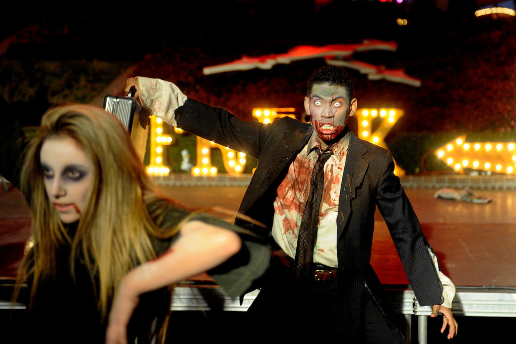 . Minnie Talarico and Sergio King dance during The Awakening, a zombie performance at Elitch Garden\'s Fright Fest 2013.   (Photo By Erin Hull/The Denver Post)