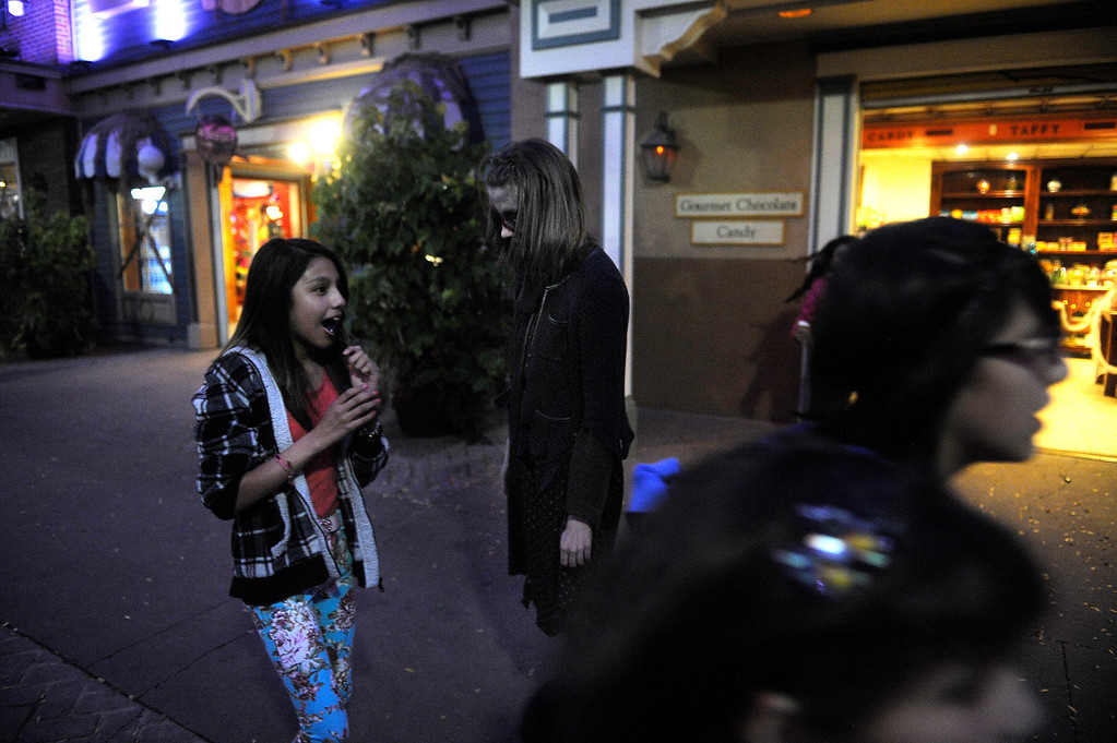 . Zombie Molly Evansen scares visitors to Fright Fest 2013 at Elitch Gardens in Denver on Oct. 11, 2013.   (Photo By Erin Hull/The Denver Post)