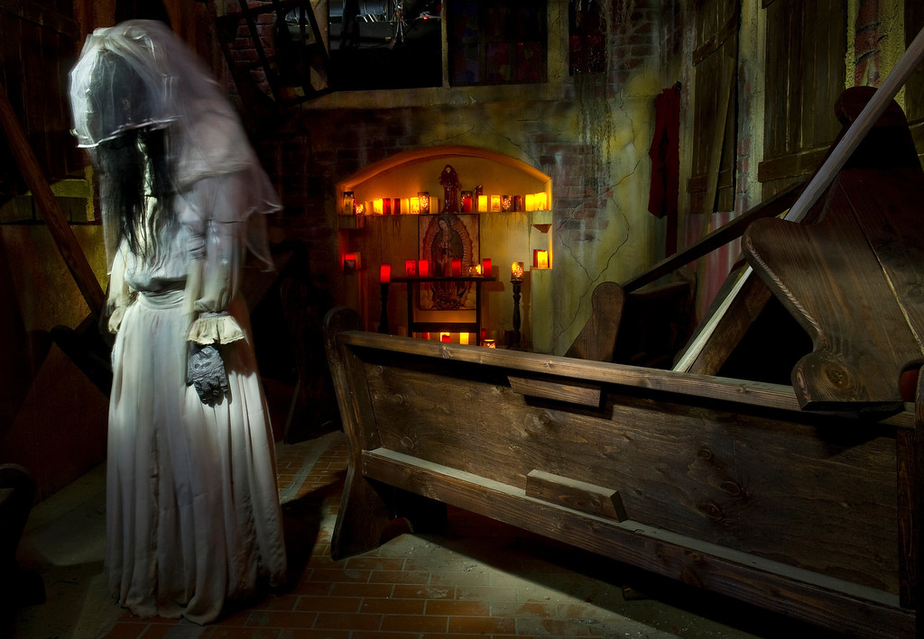 """. At the 13th Floor Haunted House in Denver, 4120 Brighton Blvd.,  on Wednesday, October 9, 2013. There are various characters on hand to scare the visitors  including \""""La Llorona\""""  who passes through the pews of the mission church. (Photo By Cyrus McCrimmon/ The Denver Post )"""