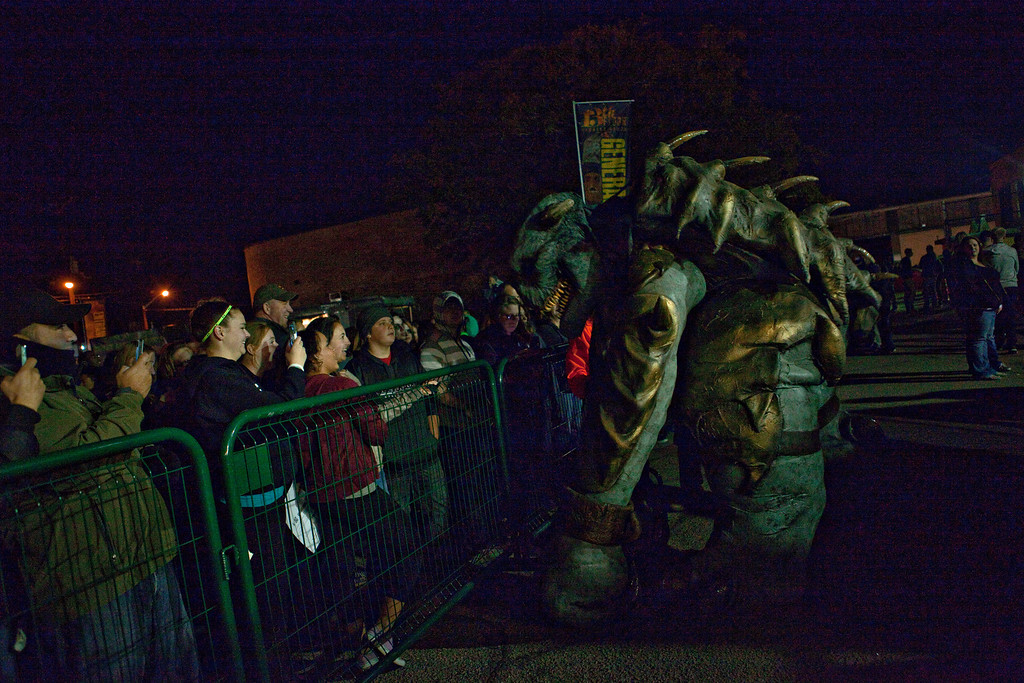 . Crowds are confronted by a Rancor at the 13th Floor Haunted House in Denver, Colorado, Saturday, October 19, 2013. The costume was created by a company in Hollywood that makes large creatures for movies. The actor inside has to be specially trained to use the arm and leg stilts to walk around. (Photo By Katie Wood/The Denver Post)