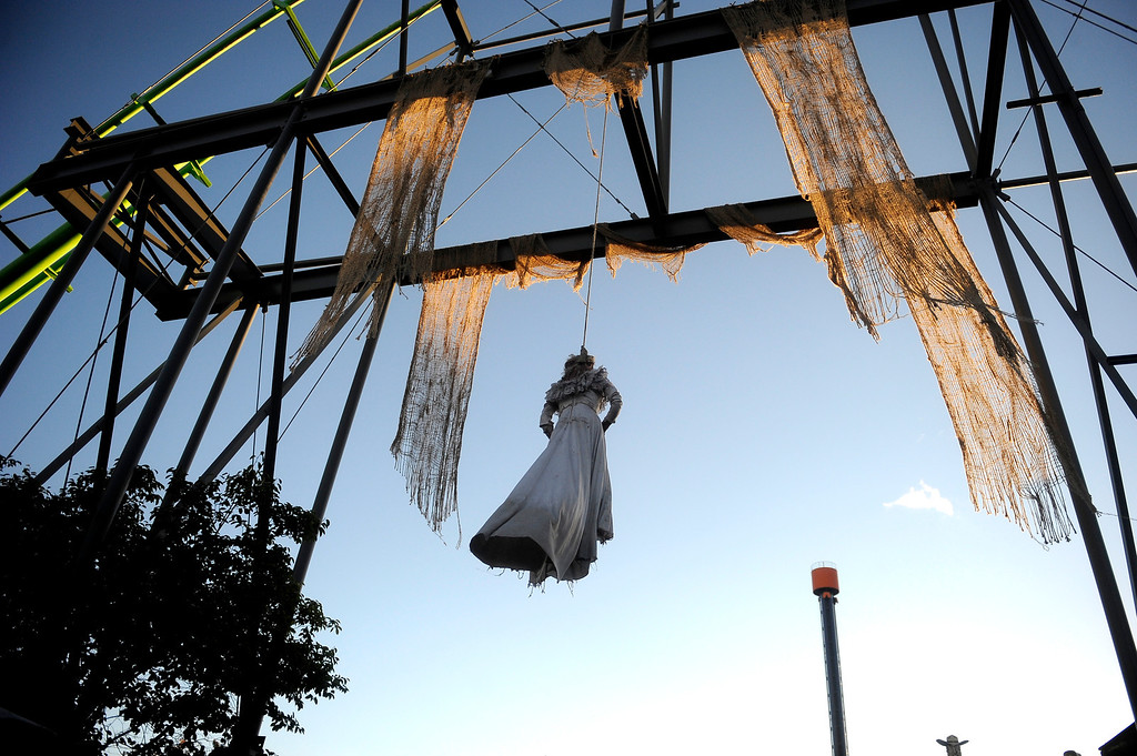 . A figure dangles from beneath a roller coaster at Fright Fest 2013 at Elitch Gardens. Fright Fest is open Friday, Saturday and Sunday nights.  (Photo By Erin Hull/The Denver Post)