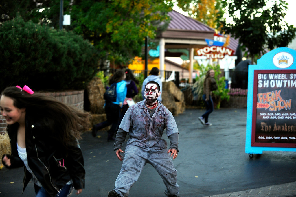 . Zombie Shawn Trujillo chases after visitors at Fright Fest 2013 at Elitch Gardens on Oct. 11, 2013.  (Photo By Erin Hull/The Denver Post)