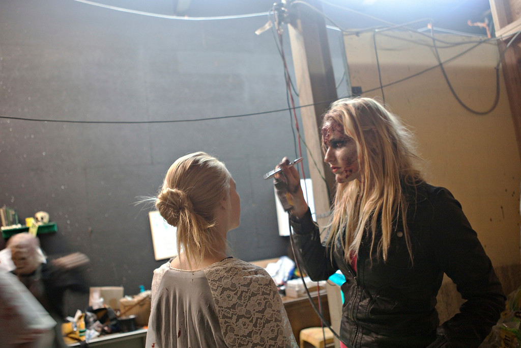 . Makeup artist Hannah Marklan helps an actor get ready at The Asylum Haunted House in Denver, Colorado, Saturday, October 19, 2013. Denver haunted houses The Asylum and the 13th Floor are both run by Screamworks Entertainment and have been recognized by MTV, The Travel Channel and USA Today as some of the best haunted houses in the country. (Photo By Katie Wood/The Denver Post)