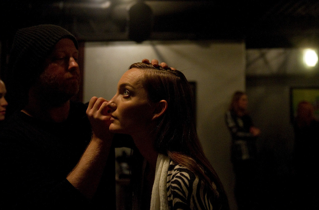 . Model Alexis Broker  gets her make up done by Charlie Price of Halo Salon before the the 28th annual MAX Fashion Show. It  was held at the Mile High Station in Denver on Friday, November 8, 2013. The event is a fund-raiser for research at Children\'s Hospital Colorado.  (Photo By Cyrus McCrimmon/The Denver Post)