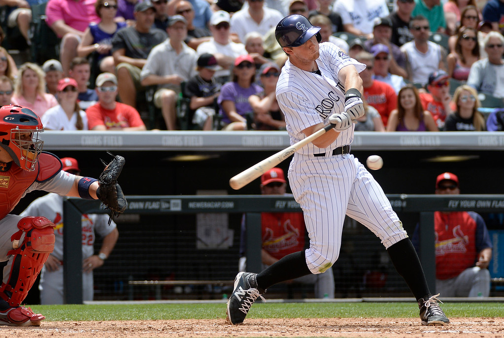 . DENVER, CO - JUNE 25: Colorado Rockies second baseman DJ LeMahieu (9) hits a RBI single to score Colorado Rockies left fielder Corey Dickerson (6) off of St. Louis Cardinals starting pitcher Marco Gonzales (56) during the fourth inning June 25, 2014 at Coors Field. (Photo by John Leyba/The Denver Post)