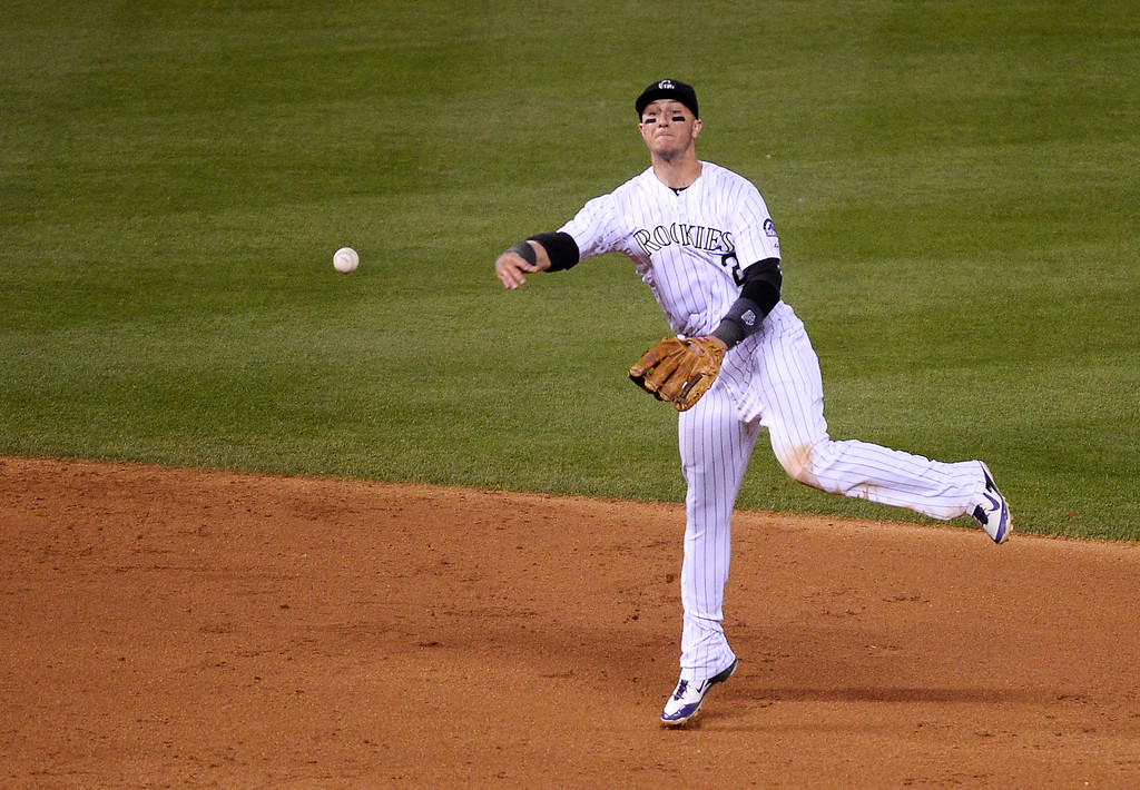 . DENVER, CO - JUNE 24: Colorado Rockies shortstop Troy Tulowitzki (2) throws out St. Louis Cardinals center fielder Peter Bourjos (8) at first base during the sixth inning  June 24, 2014 at Coors Field. (Photo by John Leyba/The Denver Post)