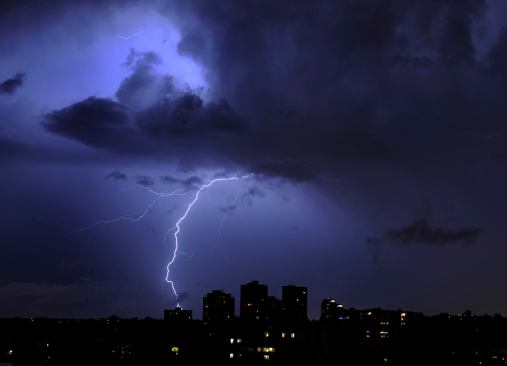 . A bolt of lightning connected with the ground as a large electrical storm passed over Denver, Colorado late Thursday night, June 11, 2009.  (Photo by Karl Gehring/ The Denver Post)