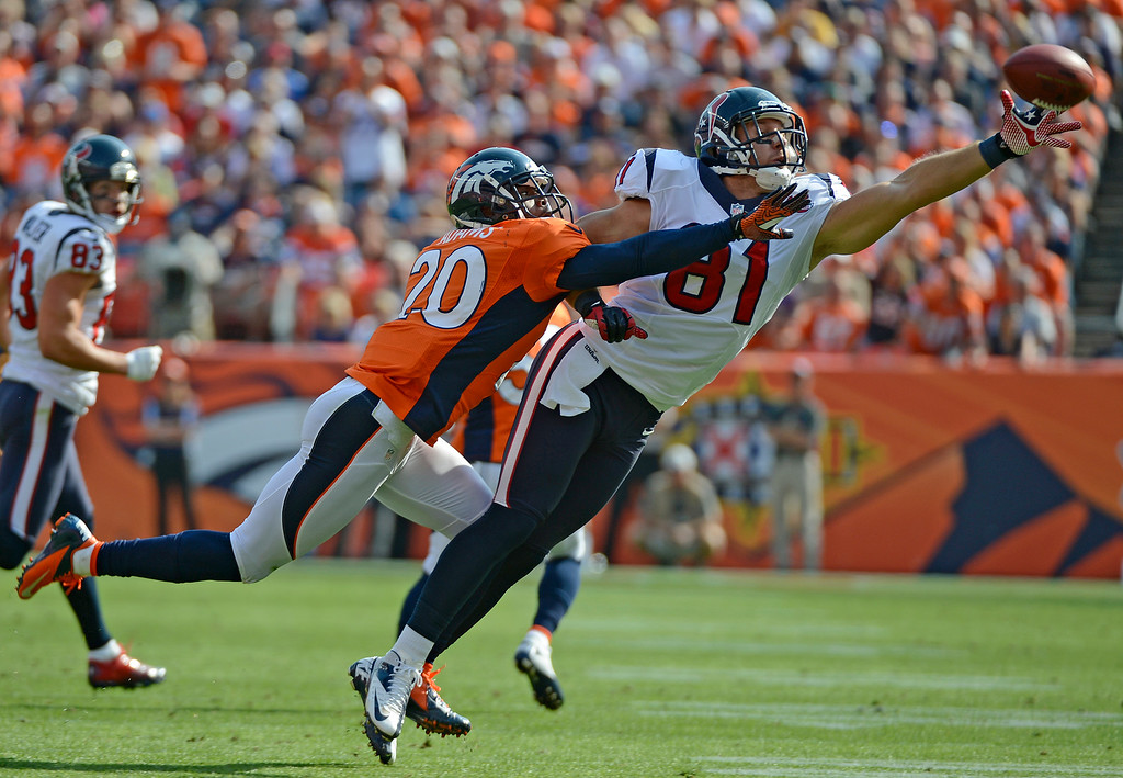 . Denver Broncos strong safety Mike Adams defends a pass to the Houston Texans\' Owen Daniels during the second quarter of play at Sports Authority Field at Mile High in Denver, CO Sunday September 23, 2012.  John Leyba/The Denver Post
