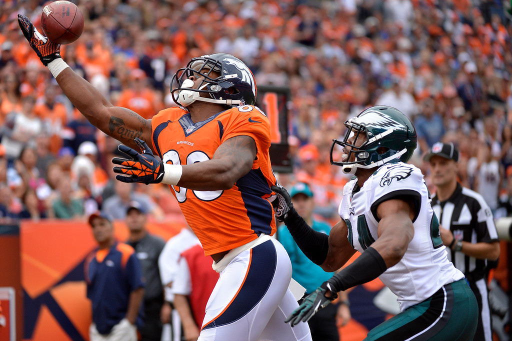 . DENVER, CO - SEPTEMBER 29: Denver Broncos wide receiver Demaryius Thomas (88) gets his hand on the ball for a third quarter touchdown over Philadelphia Eagles cornerback Bradley Fletcher (24.) The Denver Broncos took on the Philadelphia Eagles at Sports Authority Field at Mile High in Denver on September 29, 2013. (Photo by Joe Amon/The Denver Post)