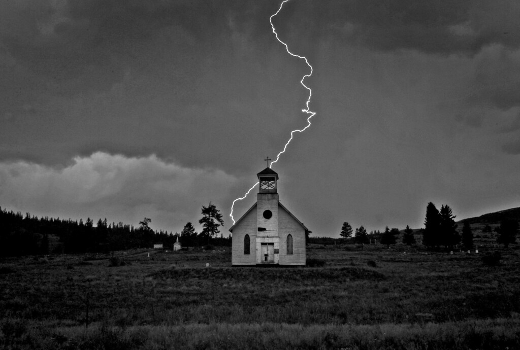 . Lighting strikes over an old church in Creede, Colorado on August 29, 2007. (Photo by RJ Sangosti/The Denver Post)