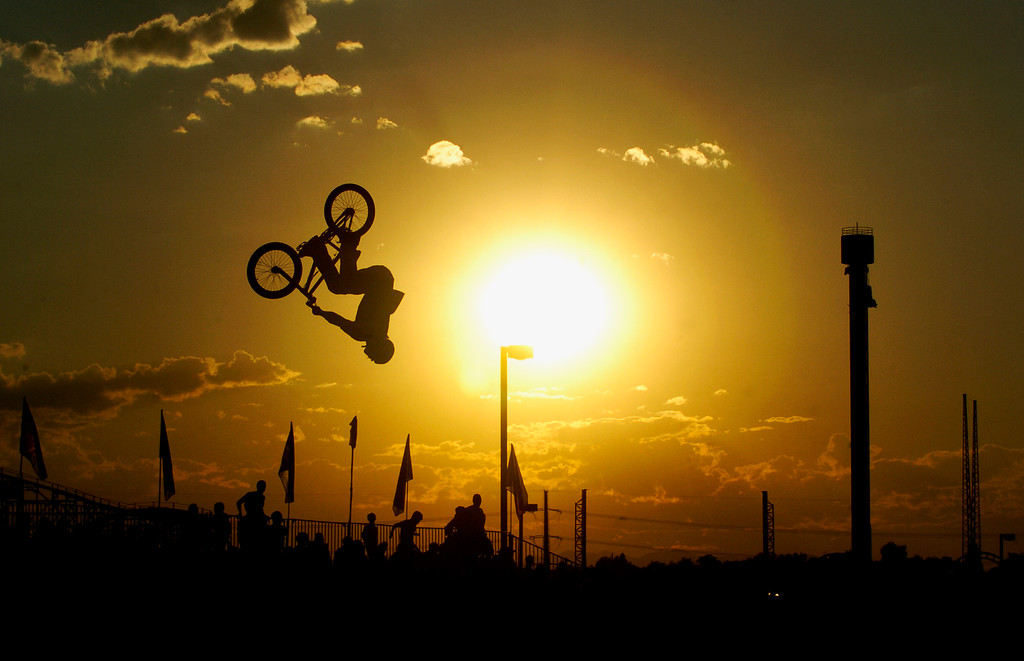 . BMX riders compete during the final round of BMX Dirt of Dew Action Sports tour in Denver on July 18, 2006. (Photo by Hyoung Change/The Denver Post)
