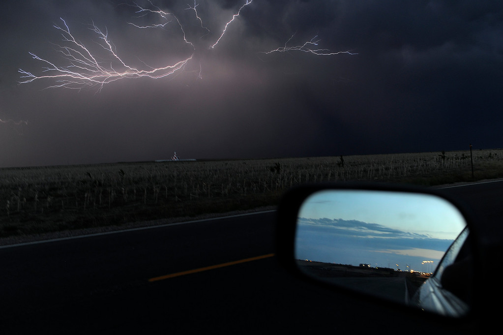 . Lightning illuminated the night in the skies south of Denver International Airport Saturday night, August 10, 2013.  (Photo By Karl Gehring/The Denver Post)