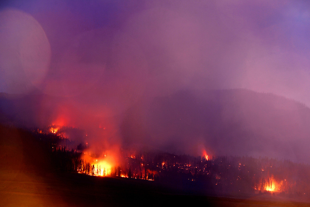 . Flames tear through the trees as the Papoose fire continues to burn south of Highway 149 near Creede, Colorado on June 24, 2013. The three fires that make up the West Fork Complex fire now top out at more than 70 thousand acres. (Photo by AAron Ontiveroz/The Denver Post)