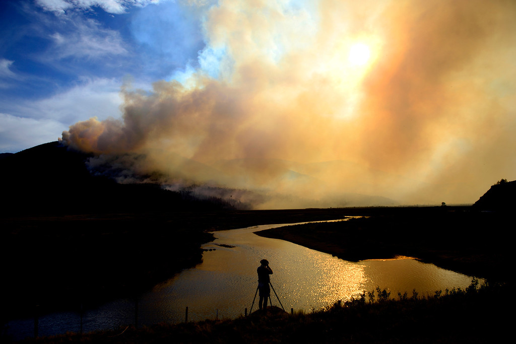 . Joe Zinn photographs the West Fork Fire as it continues to burn near Creede, Colorado on June 23, 2013. The West Fork Fire grew to more than 70,000 acres overnight. (Photo by AAron Ontiveroz/The Denver Post)
