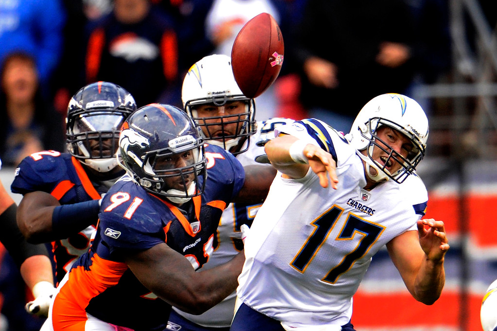 . Broncos Robert Ayers gets to Chargers quarterback Philip Rivers. Rivers fumbled the ball. Sunday October 9, 2011at Sports Authority Field at Mile High. Joe Amon,The Denver Post