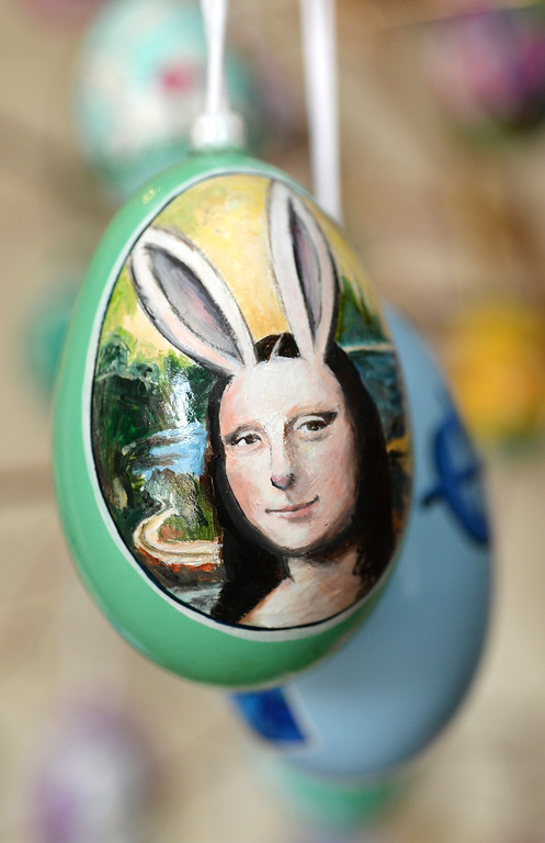 . Dave Thayer painted his version of the Mona Lisa on an easter egg. Thayer paints a handful of easter eggs each year and adds them to his tree of eggs he puts up in his living room every year. He uses oil paint and real egg shells. Thayer showed off his artwork to the Denver Post Wednesday, April 2, 2014 at his home in Denver. (Photo by Karl Gehring/The Denver Post)