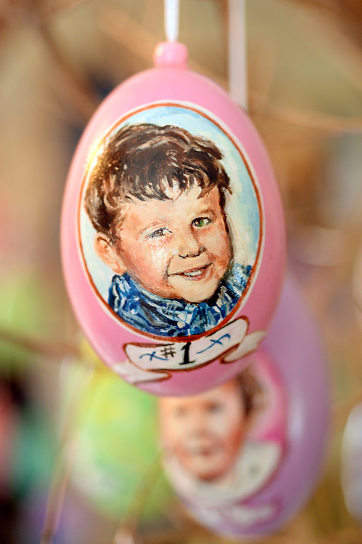 . Dave Thayer painted himself on an easter egg.  As the oldest son, his mother called him Number 1. Thayer paints a handful of easter eggs each year and adds them to his tree of eggs he puts up in his living room every year. Thayer showed off his artwork to the Denver Post Wednesday, April 2, 2014 at his home in Denver. (Photo by Karl Gehring/The Denver Post)