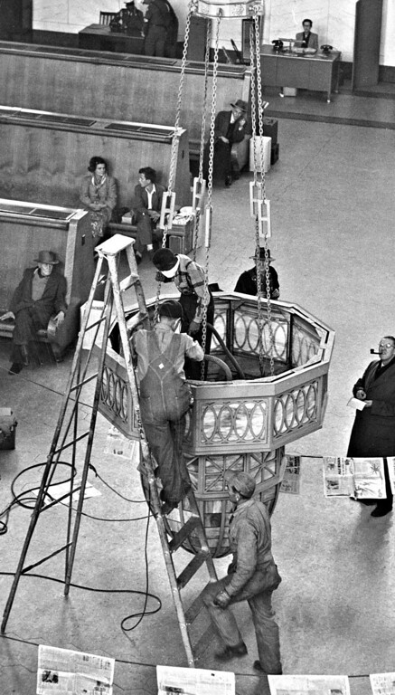 . Denver\'s Union Station Chandeliers get their semi-annual cleanup in 1953.  (Photo by Floyd H. McCall /The Denver Post)
