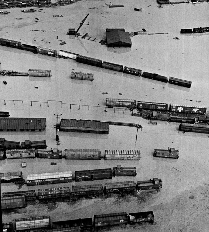 . Toppled freight cars lie in water covering Denver railroad yards north of Union Station after the June 1965 flood. Damages in South Platte River Basin were estimated at $500 million. The proposed $80 million Chatfield Dam is a key feature in plans for Denver-area flood protection.  (Photo by Ed Maker/The Denver Post)