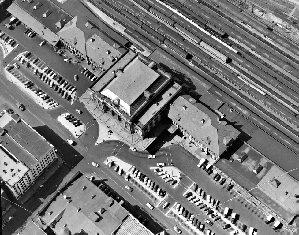 . At left is a striking photo of Denver\'s busy Union Station, the major rail transportation hub of the Rocky Mountain empire, during a period of normal traffic operations on November 2, 1953. The diagonal lines at the top of the photo are passenger trains of the many lines serving Denver as they discharge and load passengers and cargo. In the foreground are the always-busy parking lots.  (Photo by Dean Conger/The Denver Post)
