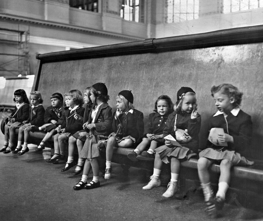 . Waiting with mixed emotions in the huge waiting room at Union Station are an adventurous crew of kindergartners from St. Mary\'s Academy. The youngsters left a few moments later for a faraway, enchanted spot-Boulder. The far from weary travelers-are (left to right) Mary Rita Dentino, Karla Ritnour, Ellen Stock, Linda Kohanski, Mary Catherine Howard, Kathy O\'Flaherty, Hilary Nelson, Phyllis Halley, Lonna Gayle Vandervort, Cassie Bruns and Martha Martin.  (Photo by Ira Gay Sealy/The Denver Post Archive)