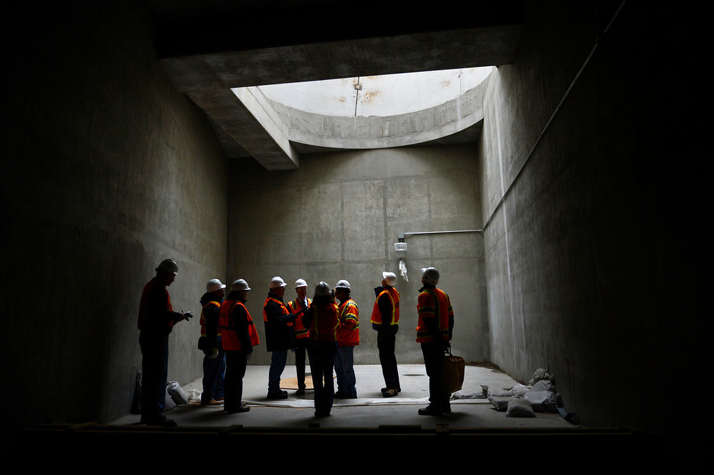 . RTD General Manager Phillip Washington and the whole tour standing in one of two exhaust vent tubes in the new underground Regional Bus Facility at the Denver Union Station project in downtown Denver, Colorado on January 29, 2013.  (Photo By Joe Amon / The Denver Post)