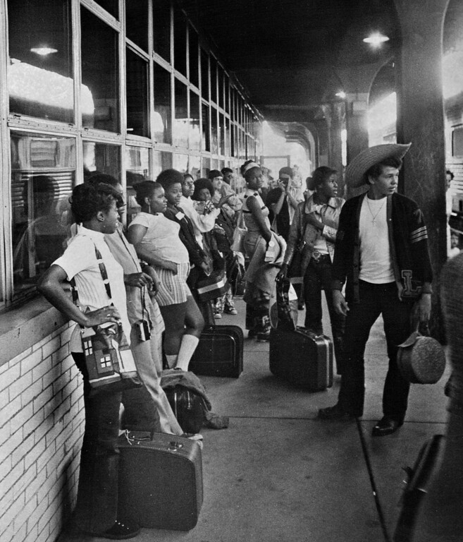 . Forty-five youngsters from Chicago wait at Denver\'s Union Station on Saturday, August 10, 1972 for a bus to take them to their temporary residences following their arrival in Denver for an eight-day stay in the area. Aged 17 and 18, they were from poor areas of Chicago and were being rewarded for their work in a Chicago Model Neighborhood Plan. The group of youths is accompanied on the trip by Erwin France, an administrative aide to Chicago Mayor Richard Daley.  (Photo by Dave Buresh/The Denver Post)