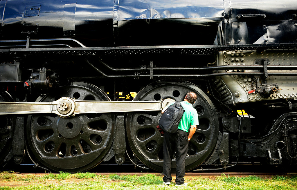 ". Marvin Mill, a design engineer, can only say ""Wow\"" as he checks out a Union Pacific legendary steam locomotive NO. 844 that was on display near Denver Union Station Friday. The No. 844 is the last steam locomotive built for the Union Pacific Railroad. It was delivered in 1944. A high-speed passenger engine, it pulled such well-known trains as the Overland Limited, Los Angeles Limited, Portland Rose, and Challenger trains.  (Photo by RJ Sangosti/ The Denver Post)"
