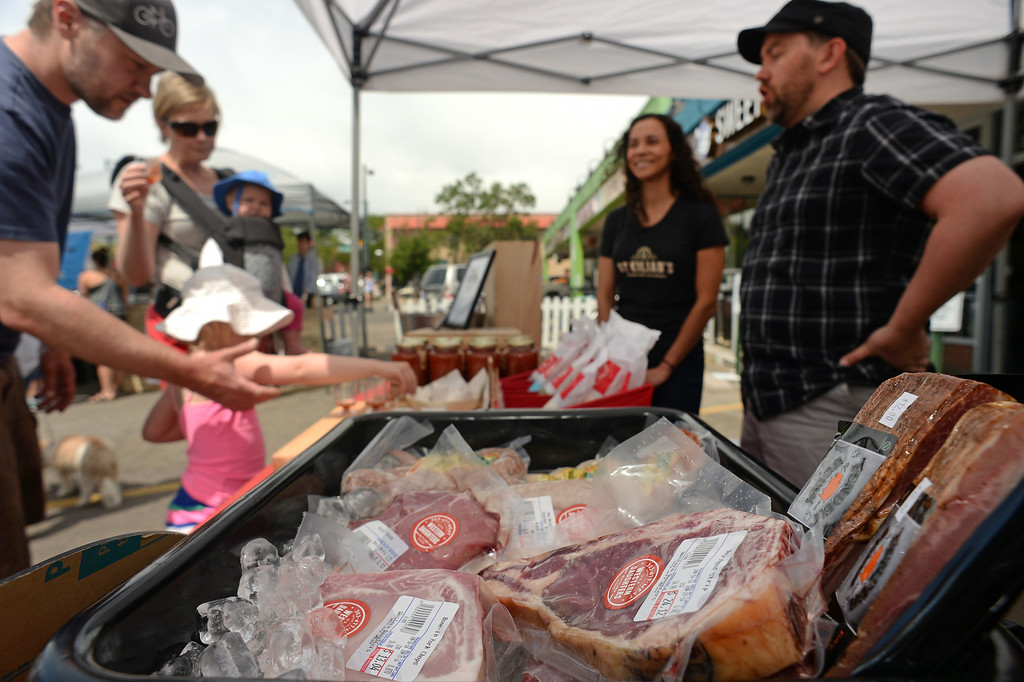 . Jon Marsh, right, owner of St. Kilian\'s Cheese Shop and Market, right, and his partner Veronica Martinez , second from right, have a tent set up at the local farmer\'s market on Lowell and 32nd street in Denver, CO on June 15, 2014.  Marsh and Martinez are the owners of St. Kilians Cheese Shop and Market which specializes in gourmet and international cheeses as well as meats and sausages. (Photo By Helen H. Richardson/ The Denver Post)