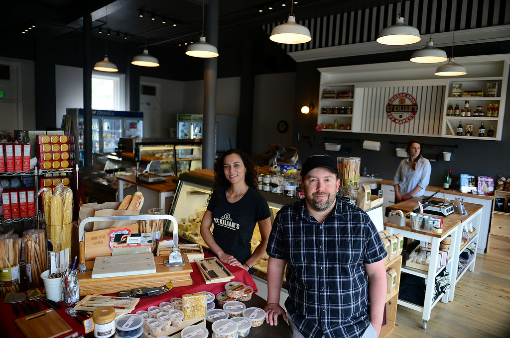 . Jon Marsh, right, owner of St. Kilian\'s Cheese Shop and Market, right, and his partner Veronica Martinez, left, and shop employee Olivia Pietrasesa, are pictured inside their store at 32nd and Lowell streets in  Denver, CO on June 15, 2014.  Marsh and Martinez are the owners of St. Kilians Cheese Shop and Market which specializes in gourmet and international cheeses as well as meats and sausages. (Photo By Helen H. Richardson/ The Denver Post)