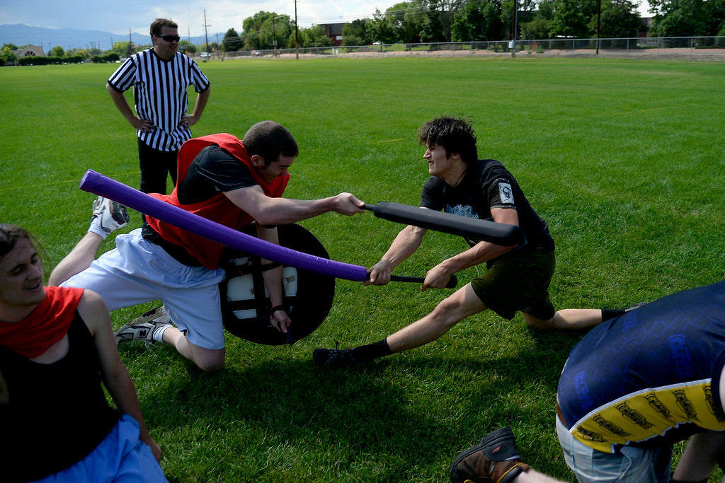 . Joshua Walker (left) and Ivan Yermilov collide midfield during an exhibition. The Colorado Jugger League exhibition and barbecue on Sunday, July 13, 2014. (Photo by AAron Ontiveroz/The Denver Post)