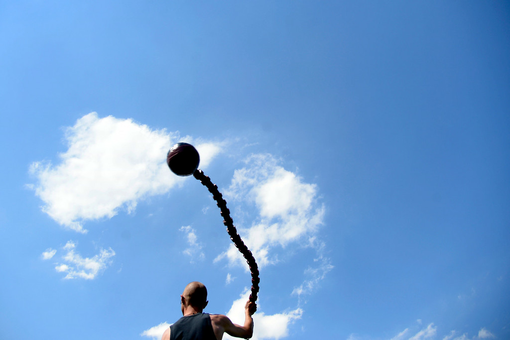 . Jess Thompson swings a ball and chain above his head duing battle. The Colorado Jugger League exhibition and barbecue on Sunday, July 13, 2014. (Photo by AAron Ontiveroz/The Denver Post)