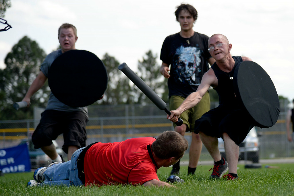 . Jess Thompson takes a red team opponent to the ground with a strike. The Colorado Jugger League exhibition and barbecue on Sunday, July 13, 2014. (Photo by AAron Ontiveroz/The Denver Post)