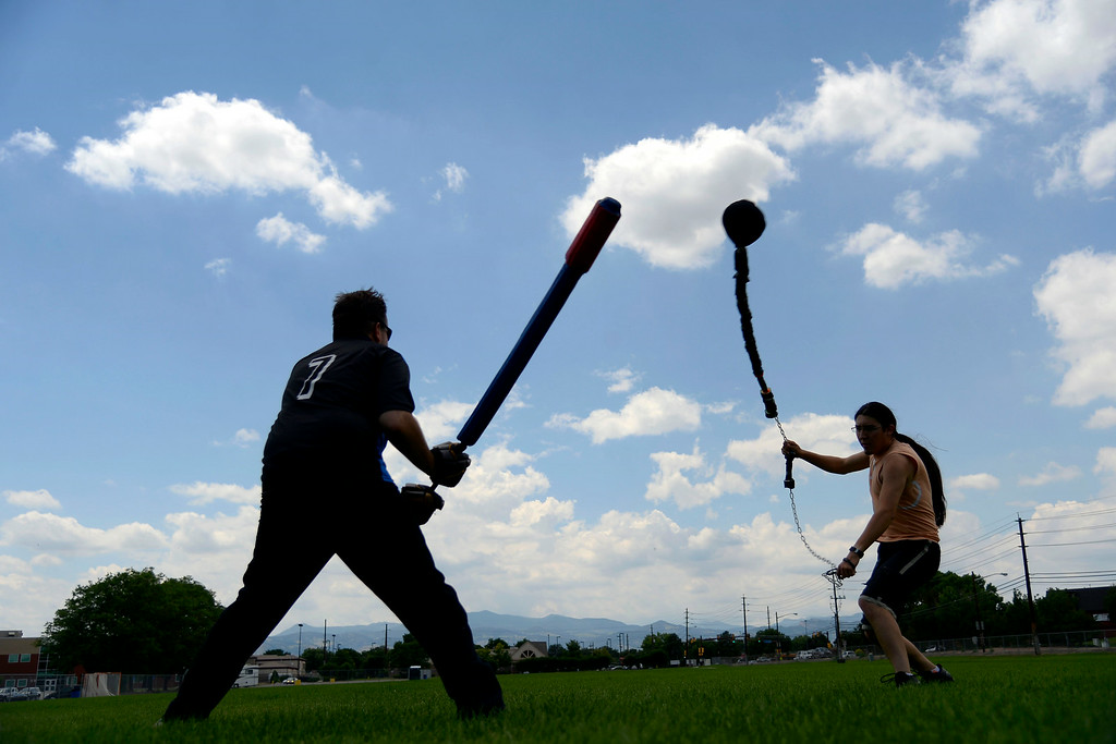 ". Jack Baxter (left) duels Miguel Alvarado as they warm up for an exhibition game with an ""iron man\"" drill in which one competitor takes on a line of men in successive order until losing. League exhibition and barbecue on Sunday, July 13, 2014. (Photo by AAron Ontiveroz/The Denver Post)"