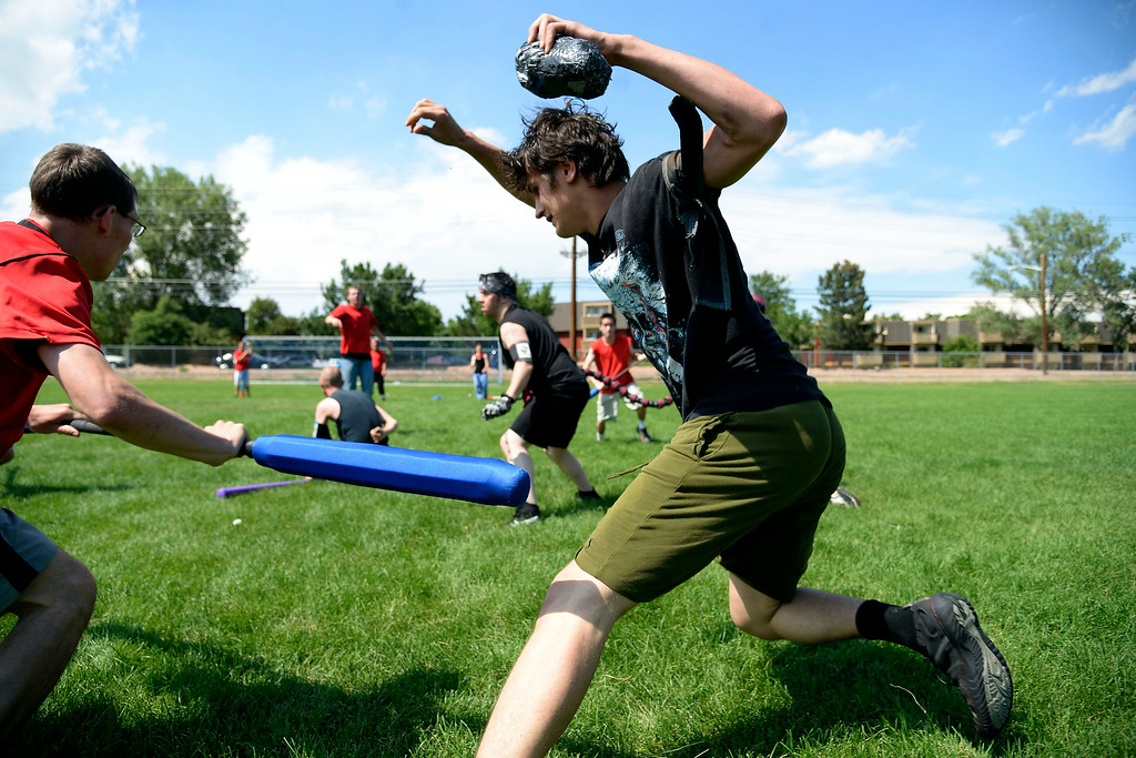 . Ivan Yermilov dodges a strike by Austin Parker during an exhibition. The Colorado Jugger League exhibition and barbecue on Sunday, July 13, 2014. (Photo by AAron Ontiveroz/The Denver Post)