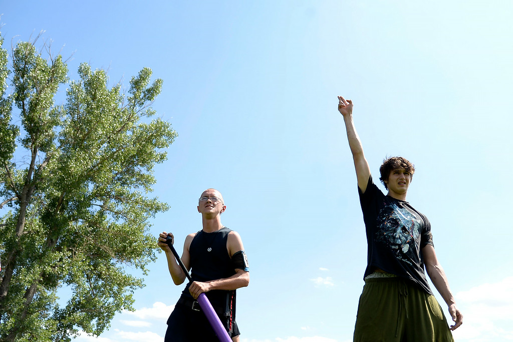 . Ivan Yermilov signals his team\'s ready status as Jess Thompson awaits the battle. The Colorado Jugger League exhibition and barbecue on Sunday, July 13, 2014. (Photo by AAron Ontiveroz/The Denver Post)
