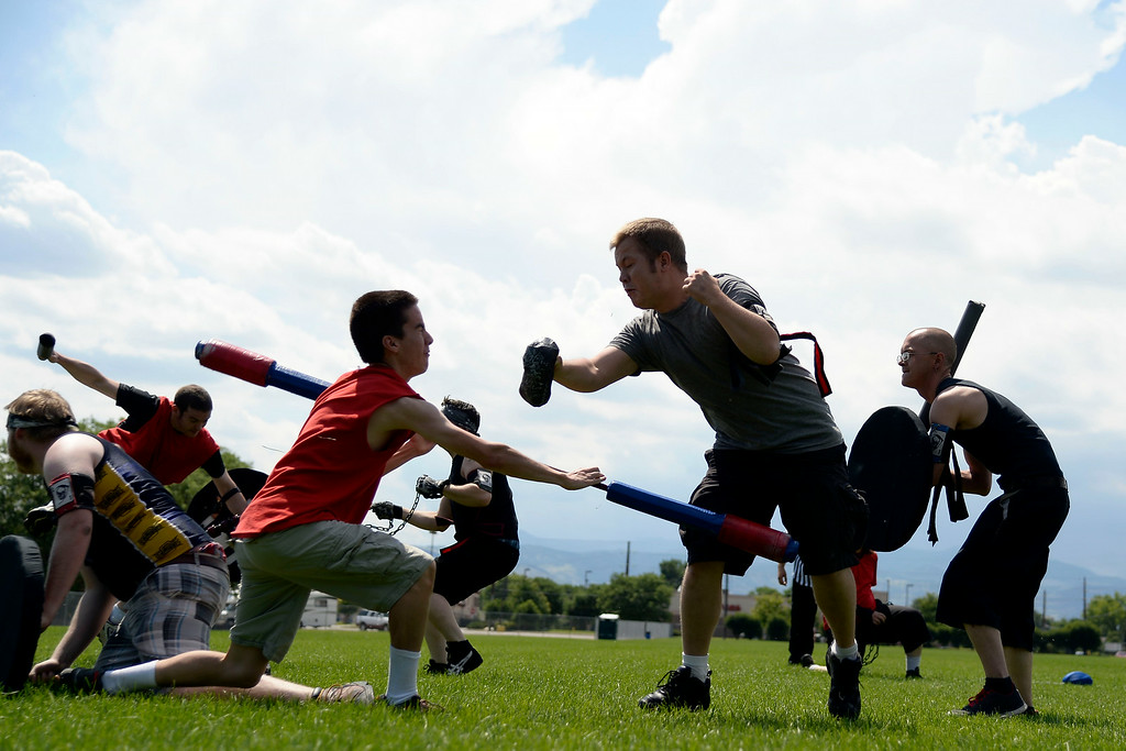 . Jett Salomonman stops the black team\'s quick, Josh Thompson, as he tries to advance the jugg. The Colorado Jugger League exhibition and barbecue on Sunday, July 13, 2014. (Photo by AAron Ontiveroz/The Denver Post)