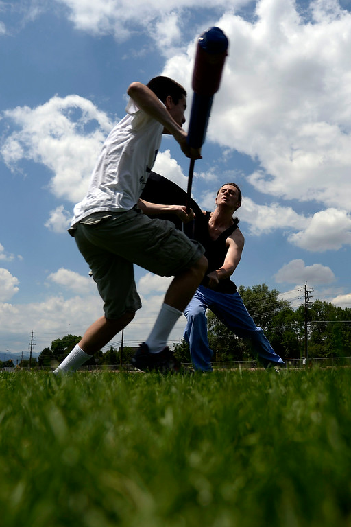 ". Quillen Verner (right) duels Jett Salomonman as they warm up for an exhibition game with an ""iron man\"" drill in which one competitor takes on a line of men in successive order until losing. League exhibition and barbecue on Sunday, July 13, 2014. (Photo by AAron Ontiveroz/The Denver Post)"