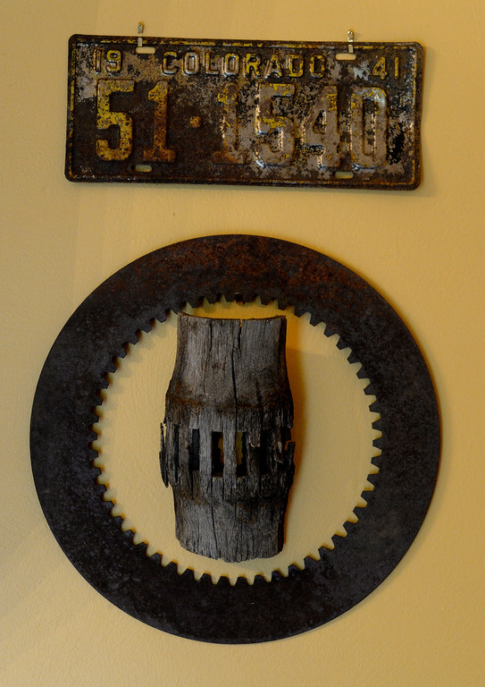 """. The living room in Cathy McNamara\'s refurbished miner\'s cabin in Georgetown, Colo. has an old Colorado license plate for decoration. The cabin was built in the 1870sand will be on the upcoming Georgetown home tour \""""Brides, Bells and Barons\"""" on July 26th.  (Denver Post Photo by Cyrus McCrimmon)"""