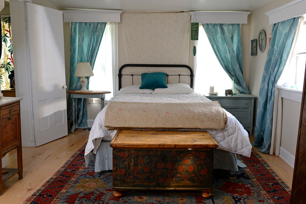 """. The master bedroom in Cathy McNamara\'s refurbished miner\'s cabin in Georgetown, Colo. is the original space of the one room dwelling. It was built in the 1870s. IThe home will be on the upcoming Georgetown home tour \""""Brides, Bells and Barons\"""" on July 26th.   (Denver Post Photo by Cyrus McCrimmon)"""