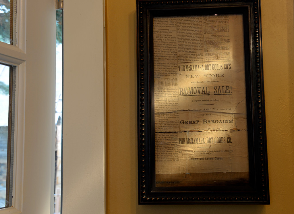 """. McNamara has decorated with antique newspapers. This one features an ad for McNamara Dry Good Store in Denver. The cabin was built in the 1870s and will be on the upcoming Georgetown home tour \""""Brides, Bells and Barons\"""" on July 26th.  (Denver Post Photo by Cyrus McCrimmon)"""