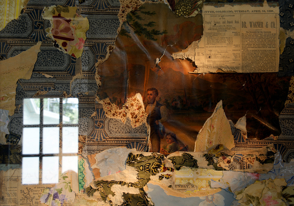 """. McNamara has decorated her refurbished miner\'s cabin in Georgetown, Colo. with antique newspapers and wall papers salvaged from the space. The cabin was built in the 1870s and will be on the upcoming Georgetown home tour \""""Brides, Bells and Barons\"""" on July 26th.  (Denver Post Photo by Cyrus McCrimmon)"""