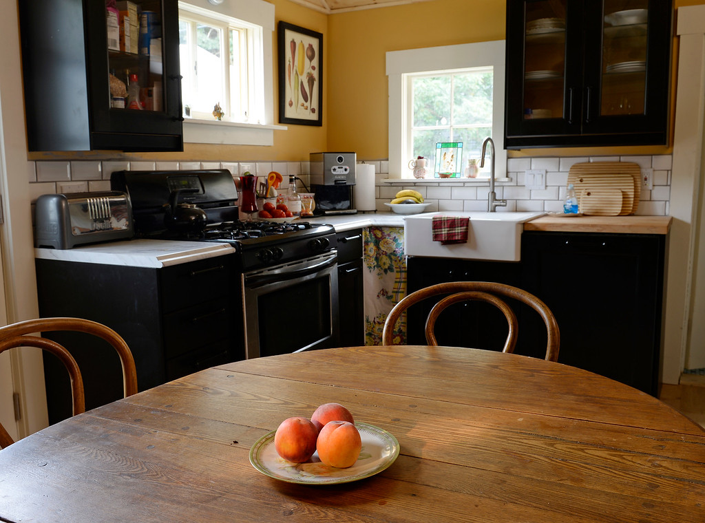 """. The kitchen in Cathy McNamara\'s refurbished miner\'s cabin in Georgetown, Colo. It was built in the 1870s and will be on the upcoming Georgetown home tour \""""Brides, Bells and Barons\"""" on July 26th.   (Denver Post Photo by Cyrus McCrimmon)"""
